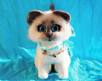 The blue-Eyed cat toy made of wool
