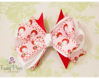 PInk and red Strawberry Shortcake Hello Kitty bow.  Valentines Day.  Hearts. Back to school.  Birthday girl.