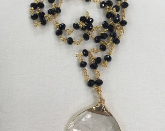Black beaded chain with Quartz Pendant