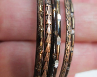 Six copper stacking bracelets