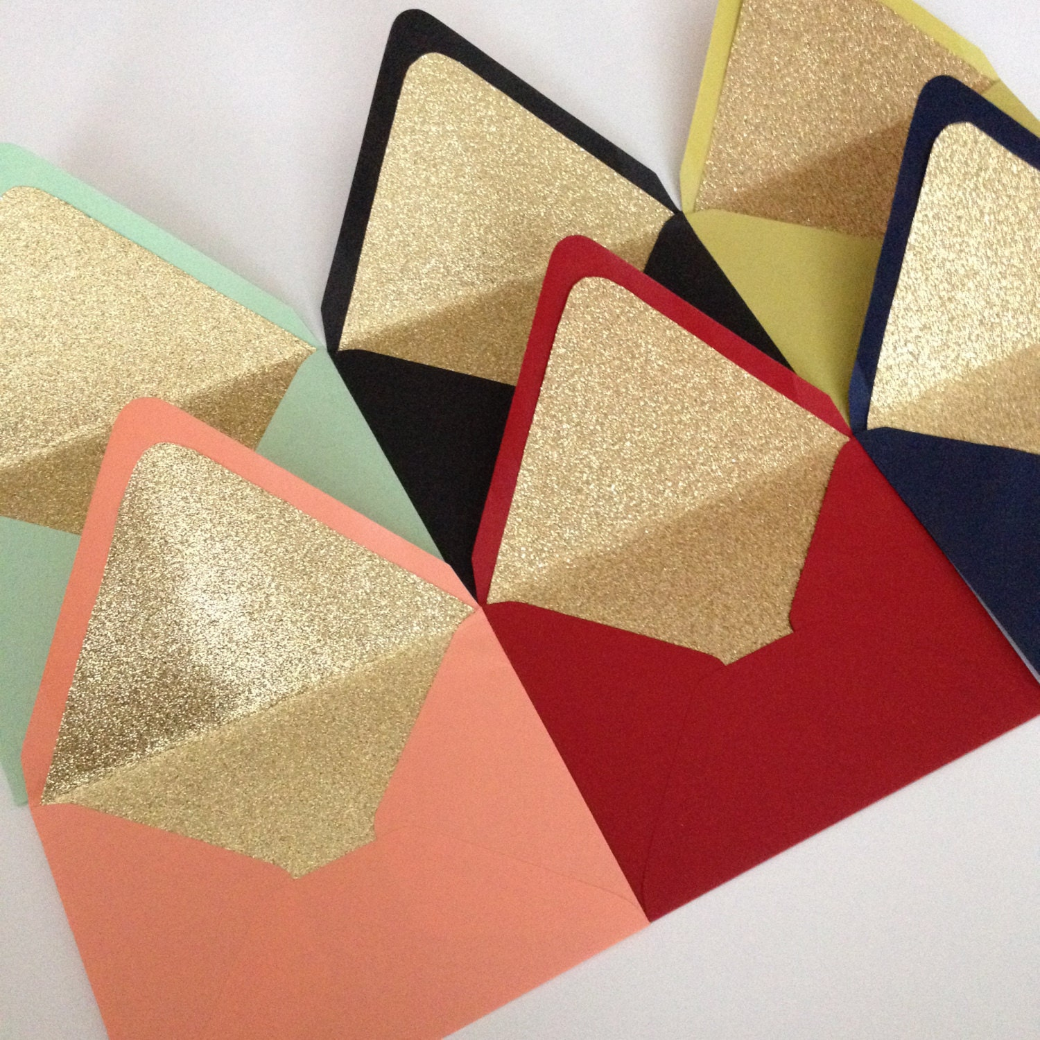 https://www.etsy.com/listing/210127342/set-of-10-gold-glitter-lined-envelopes?ref=shop_home_active_9