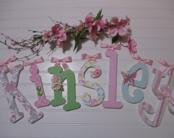 KINSLEY - 12.00 PER LETTER Gilrl name, wooden letters, whimsical font, light pink, lime green, yellow, butterfly, buttons, bows, flowers