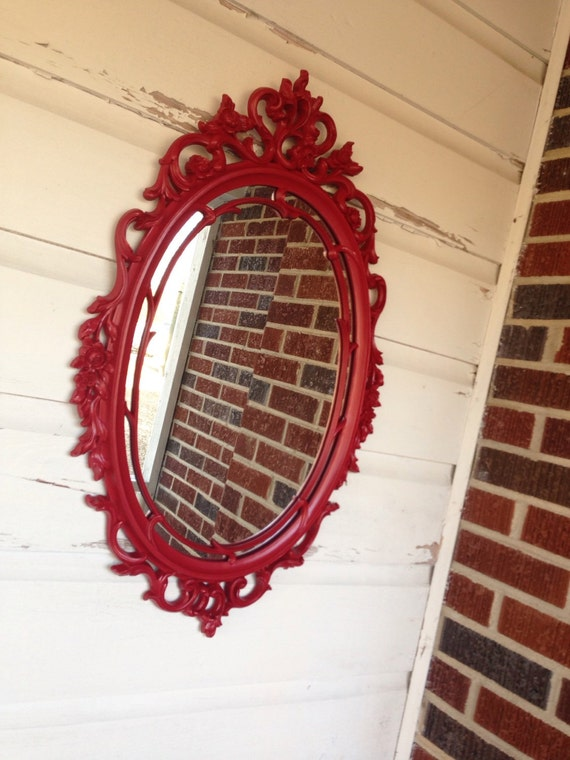large red baroque mirror