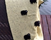 Wool knit baby blanket. Soft alpaca pastel pale yellow w crochet black sheep applied. Newborn baby wrap hand made blanket. Baby shower gift.