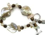 Shell Bracelet beaded iridescent shell beadwork handmade swarovski crystal glass silver toggle