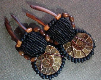 stick sawa wood ear weights, thread wrapped with ammonites, woven glass and wooden beads and copper wire