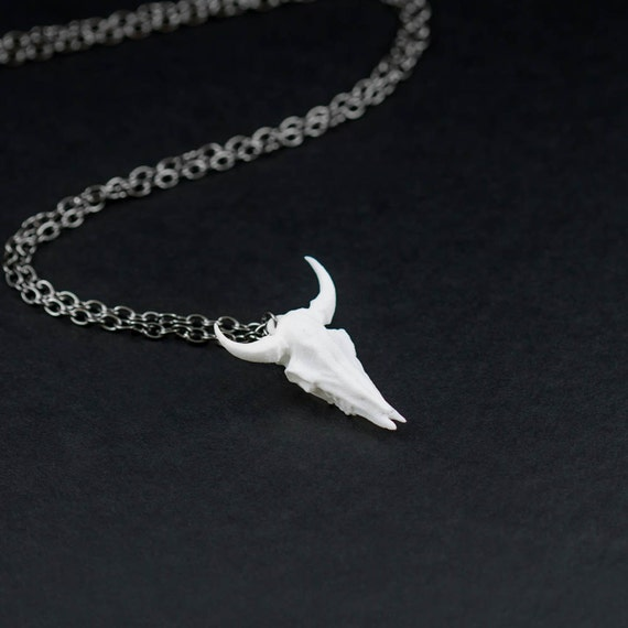 Bison Skull Necklace in white - A white bison skull necklace on a gunmetal chain to adorn your neck