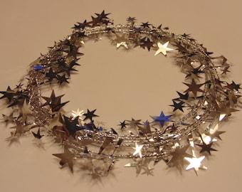 8 feet of shinny silver star garland, (HR22)