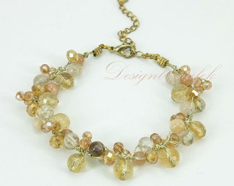 Citrine and crystal hand knotted on silk bracelet.