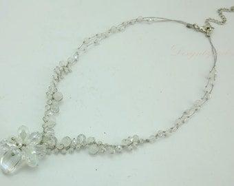 Flower crystal on silk necklace.