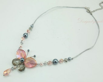 Butterfly crystal,grey shell on silk necklace.