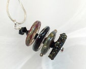 Glass necklace black green red art lampwork bead disks with black crystals