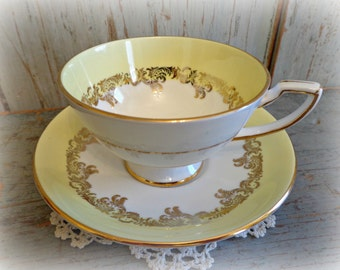 vintage yellow & gold trim tea cup / english royal stafford