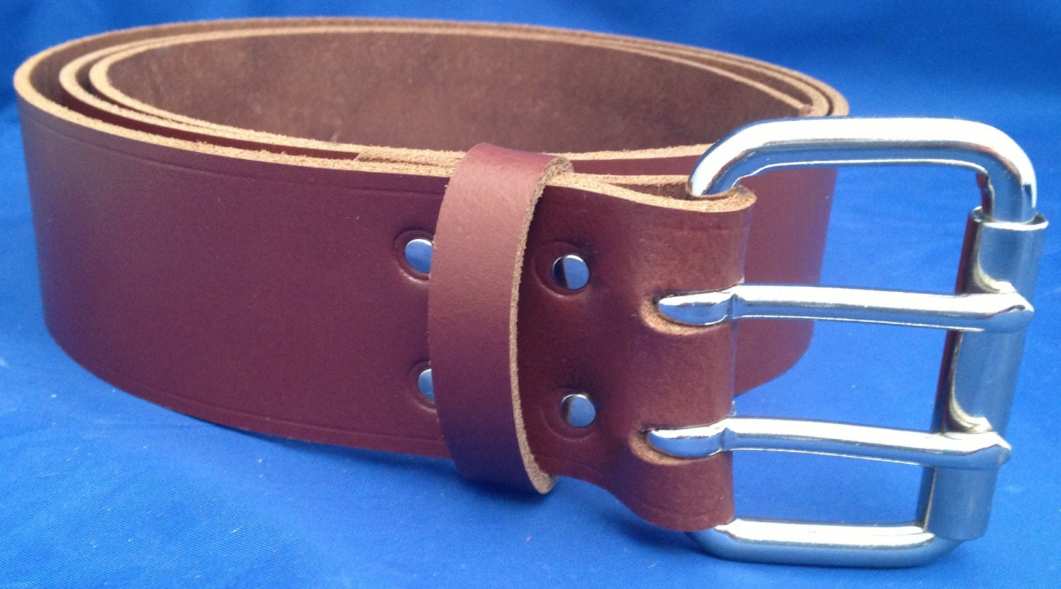 light brown leather 2 inch wide belt with 2 pronged buckle