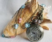 Pocket watch pendant, features assorted charms and heart shaped lampwork beads on antique bronze chain