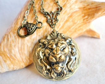 Lion photo locket, round bronze locket with lion on front cover.