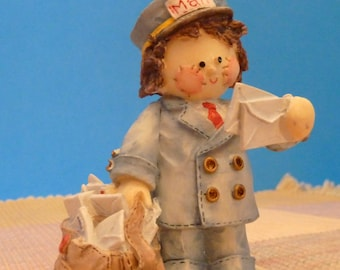 Miniature Figurine of a Rag Doll Mail Carrier by Mary Rhyner for Enesco 1993.