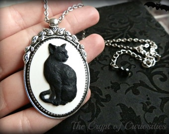 Antique silver black cat cameo necklace.