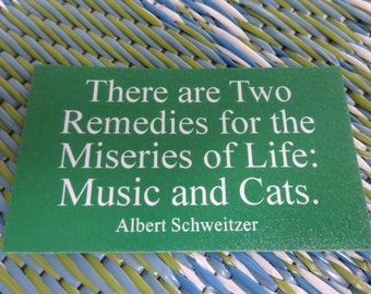 There are Two Remedies for the Miseries of Life - Music and Cats Refrigerator Magnet. A Fridge Magnet for Cat and Music Lovers.