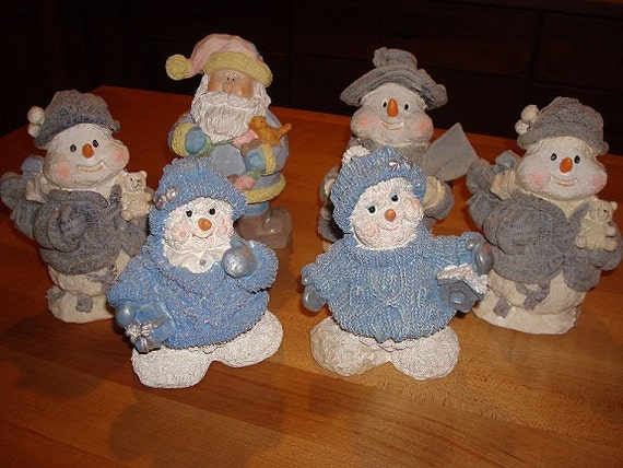 Items similar to santa claus and snowmen resin figurines
