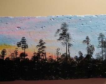 Painted brick featuring a swamp scene at sunset