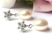 Freshwater pearl drop bridal earrings set on Sterling silver with dainty sparkling CZ flower fitment