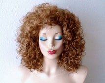 Cosplay wig.  Golden blonde / Dirty blonde color Shoulder length heavy curly hairstyle wig. Adult Halloween Costume wig.