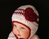 Crochet Baby Hat with Heart perfect for Valentines Day.  Warm ear flaps and ties under the chin