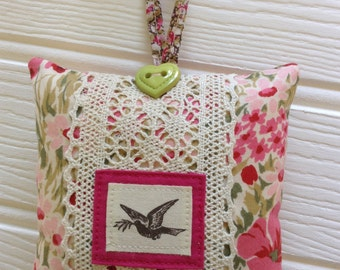 Hanging decorative mini pillow and door hanger