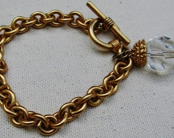 Large Link Gold Chain Bracelet with Toggle Clasp and Clear Bead Accent