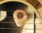 Beautiful maple wood guitar pick with leather friction pads.