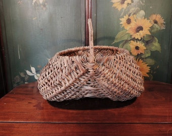 Wicker basket, a traditional, vintage french, basket for gathering fresh produce such as herbs, fruit, or mushrooms