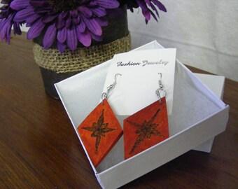 Wood earrings, wood burn earrings, orange diamond shaped rustic/boho earrings with wood burning graphic design.