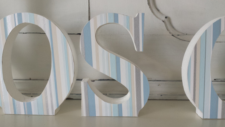Pale blue Nos Da free standing wooden decoupaged letters. 15 cm high