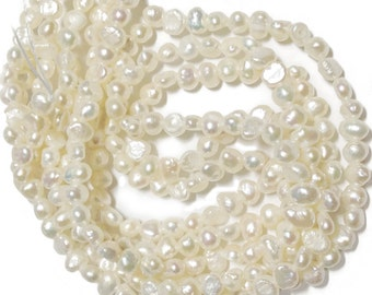 White petite nugget pearls.   Approx. 4mm across.  Select a strand length.