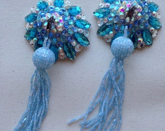 Blue pasties with tassel