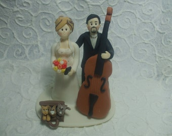 custom bride and  groom with music instrument wedding cake topper