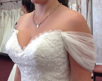 Detachable off the shoulder straps. Soft-drape tulle dotted with Swarovski crystals. Listing #67
