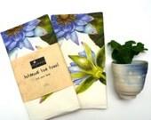 Linen tea towel, featuring original botanical art of the blue water lily by Australian artist.