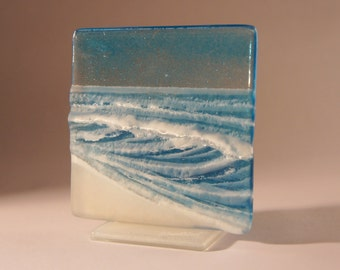 "Blue Seaside Upstand - The Small Wave - fused glass windowsill panel 12cm (3 3/4"") square on 1 foot"