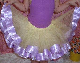 Sunny yellow tulle tutu trimmed in a wide lilac ribbon