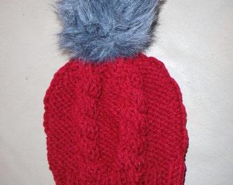 Burgundy knit hat with burgundy or gray pom pom