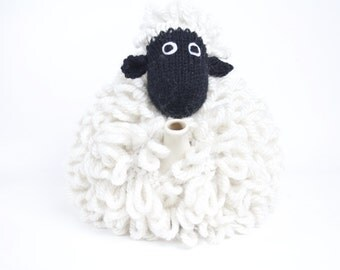 Mabel the sheep tea cosy hand knitted in chunky cream yarn
