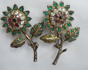 Pair Danecraft brooches,red crystals surrounded by clear with green petals sold as pr.