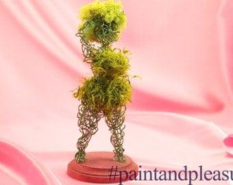 Green moss topiary goddess in a bikini with an afro