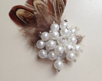 Feathers and pearls embellishment