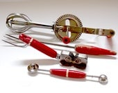 Set of Red Handled Vintage Utensils / Egg Beater, Serving Fork, Knife Sharpener, Melon Baller