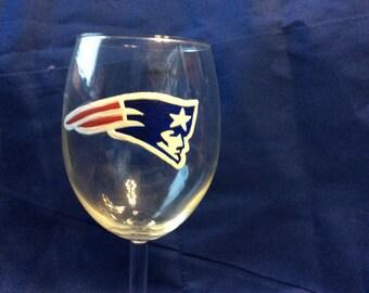 New England Patriots wine glass.