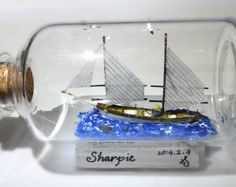 Tiny ship in the tiny bottle the Sharpie with a old man in the sea