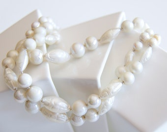 Vintage triple strand pearlescent bead necklace, carved pearlescent beads